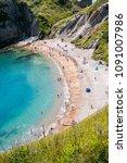 durdle door  dorset in uk ... | Shutterstock . vector #1091007986