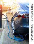 charging modern electric car on ... | Shutterstock . vector #1091011382