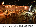 plastic chairs in a mixed order ... | Shutterstock . vector #1091029988