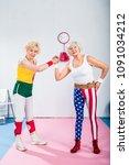happy senior sportswomen... | Shutterstock . vector #1091034212