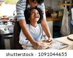 mother and son kneading dough... | Shutterstock . vector #1091044655