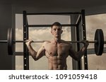sport and gym concept. man with ... | Shutterstock . vector #1091059418