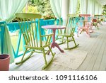 pink and green wooden rocking... | Shutterstock . vector #1091116106