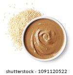 bowl of tahini sauce  paste ... | Shutterstock . vector #1091120522