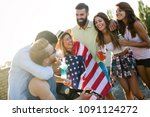 friends celebrating 4th of july ... | Shutterstock . vector #1091124272