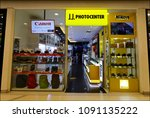Small photo of KHONKAEN, THAILAND - MAY 15, 2018: JJ Photocenter Khonkaen branch business sale and service of EOS CANON, NIKON, SONY, OLYMPUS lens,Cameras, bags and printers It is a premium sale and retail