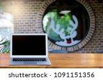 blank screen laptop on wooden...   Shutterstock . vector #1091151356