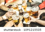 friends hands drinking beer at... | Shutterstock . vector #1091215535