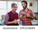 mid adult man is showing his... | Shutterstock . vector #1091218685
