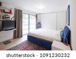 bedroom with window and garden... | Shutterstock . vector #1091230232