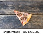piece of pizza with mushrooms...   Shutterstock . vector #1091239682