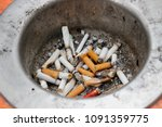 ashtray with heap of cigarette... | Shutterstock . vector #1091359775
