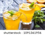 orange cocktail with ice and... | Shutterstock . vector #1091361956