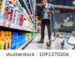 man can't decide in store what... | Shutterstock . vector #1091370206