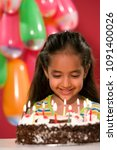 a girl looking at her birthday... | Shutterstock . vector #1091400026