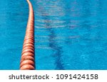 swimming pool with red buoys on ... | Shutterstock . vector #1091424158