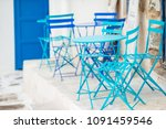 blue chairs and table on street ...   Shutterstock . vector #1091459546