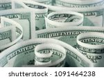 American dollar banknotes rolled, curved in different directions. Money background. - stock photo