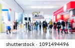 blurred people at a trade fair... | Shutterstock . vector #1091494496