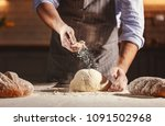 hands of the baker's male knead ... | Shutterstock . vector #1091502968