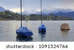 boats covered with tarpaulin on ... | Shutterstock . vector #1091524766