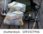 fishing tackle on wooden... | Shutterstock . vector #1091527946