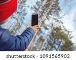 the child uses the phone in... | Shutterstock . vector #1091565902
