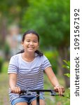 asian teenager riding bicycle... | Shutterstock . vector #1091567192