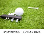 golf ball and tee are on green... | Shutterstock . vector #1091571026