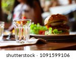 empty cocktail glasses on table ...   Shutterstock . vector #1091599106