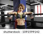 sexy boxing girl stands leaned... | Shutterstock . vector #1091599142