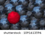 a red umbrella stands out...   Shutterstock . vector #1091613596