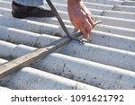 asbestos removal. roofer safe... | Shutterstock . vector #1091621792