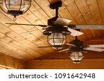 ceiling fan in a wooden cabin