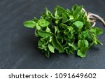 fresh green mint on a black... | Shutterstock . vector #1091649602