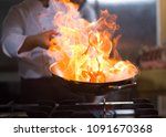 chef cooking and doing flambe... | Shutterstock . vector #1091670368