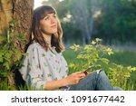 young woman sending message... | Shutterstock . vector #1091677442