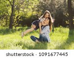 candid loving family of mother... | Shutterstock . vector #1091677445