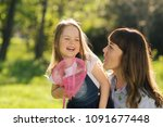 candid loving family of mother... | Shutterstock . vector #1091677448
