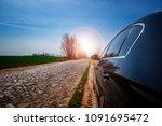 car on asphalt road in summer | Shutterstock . vector #1091695472