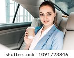businesswoman holding cup of... | Shutterstock . vector #1091723846