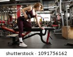 the girl in the gym with a... | Shutterstock . vector #1091756162