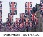 union jack flags hang in... | Shutterstock . vector #1091764622