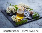 jar of acacia honey with a... | Shutterstock . vector #1091768672