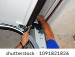 repairman repair garage door... | Shutterstock . vector #1091821826