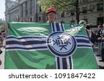 Small photo of A young man wearing a MAGA hat holds a Kekistan flag at the Day for Freedom event in Whitehall, London. 06/05/18