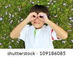 cheerful boy laying on the... | Shutterstock . vector #109186085