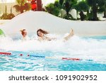 two girls in an aquapark on a... | Shutterstock . vector #1091902952