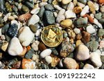 the coin ethereum lies on the... | Shutterstock . vector #1091922242