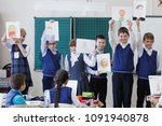 pupils at the lesson hand over... | Shutterstock . vector #1091940878